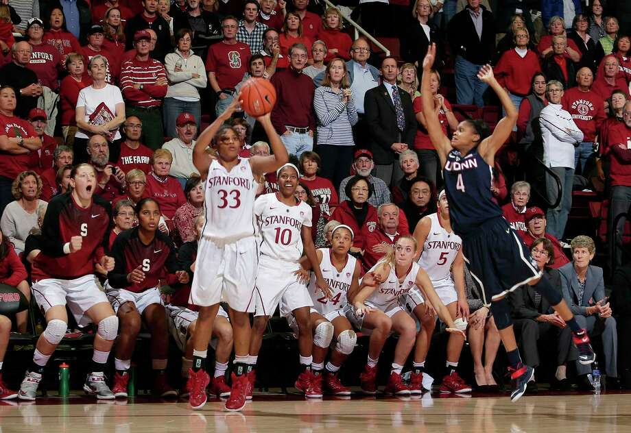 Stanford guard Amber Orrange (33) makes a three-point basket to send the game into overtime over Connecticut guard Moriah Jefferson (4) on Monday, Nov. 17, 2014, in Stanford, Calif. Stanford won 88-86 in overtime. (AP Photo/Marcio Jose Sanchez) Photo: Associated Press, STF / AP