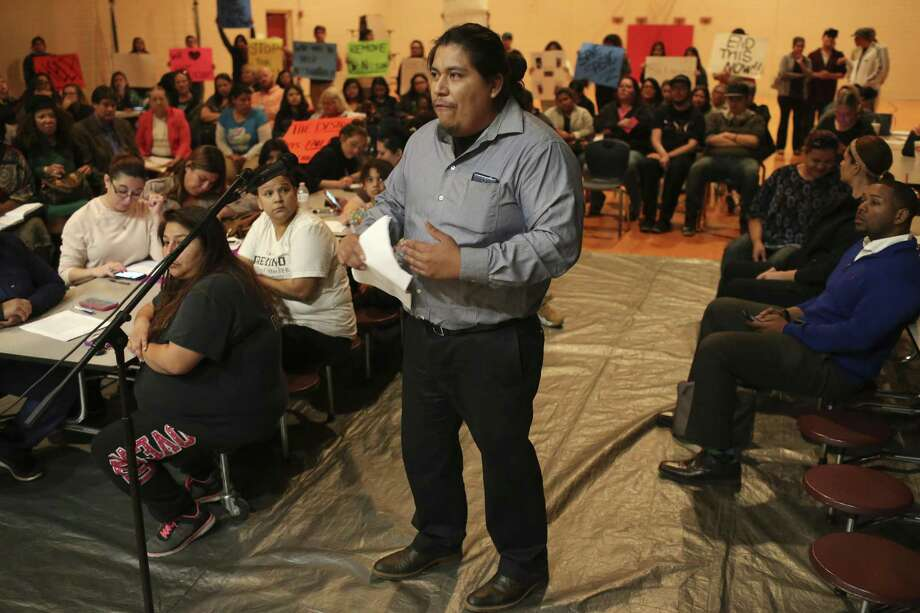 Jhonatan Tello expresses his concerns before two board members of the San Antonio School for Inquiry & Creativity, (SASIC), at their Preparatory Academy campus on Fredericksburg Road, Wednesday, Feb. 15, 2017. Tensions are bubbling over at SASIC, a small charter district beset by an array of complaints of corruption, mismanagement and negligence. Students and parents accuse the district of a range of offenses, including serving spoiled food to students, not providing toilet paper and soap in the bathrooms, and not paying employees, among many others. On Wednesday, parents and community members expressed their grievances at an open forum before board president Denise Fritter and member Nathan Wiegreffe. Photo: JERRY LARA, Staff / San Antonio Express-News / © 2017 San Antonio Express-News