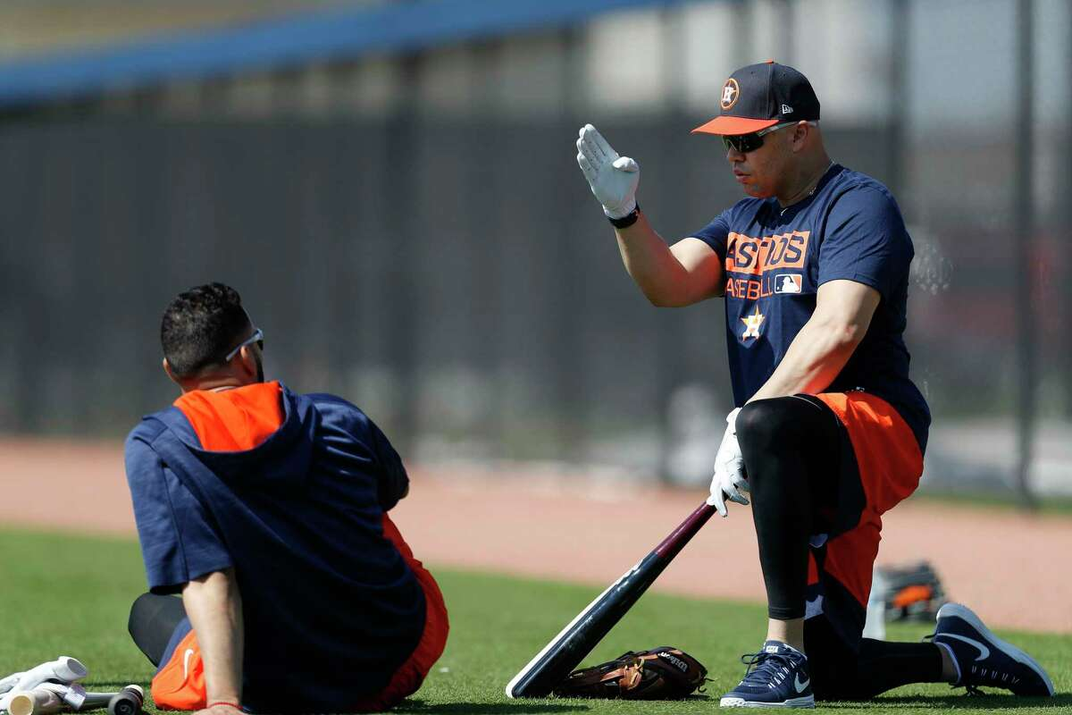 Houston Astros designated hitter Carlos Beltran chats with Marwin Gonzalez as they waited to take batting practice during spring training at The Ballpark of the Palm Beaches, in West Palm Beach, Florida, Friday, February 17, 2017. ( Karen Warren / Houston Chronicle )