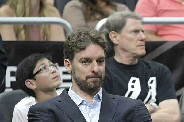 Spurs center Pau Gasol watches from the bench during the second half against the Magic in Orlando, Fla., on Feb. 15, 2017.