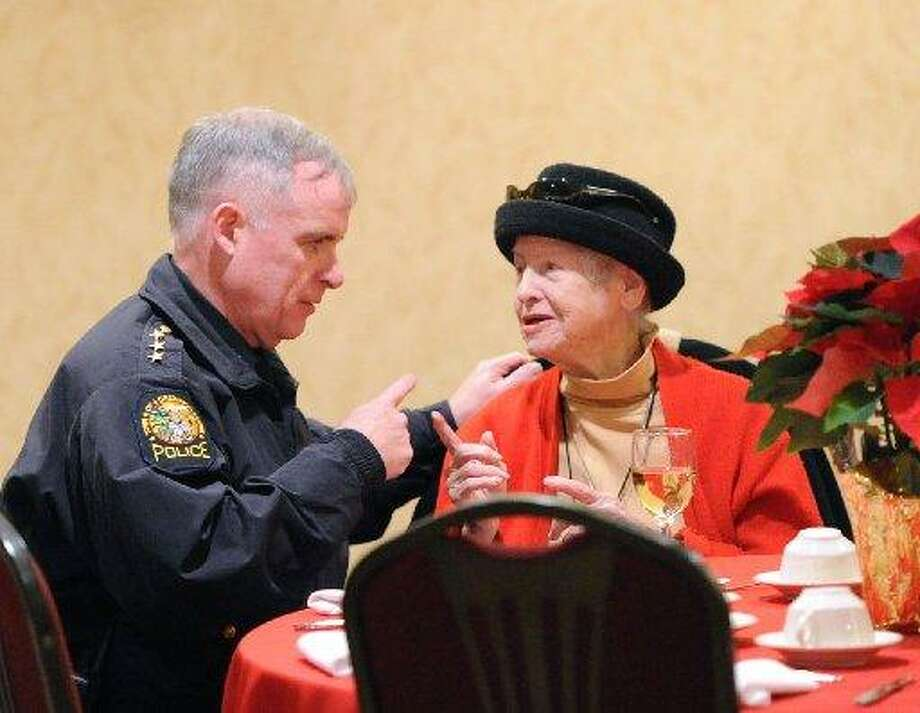 Anne Carson chats with Police Chief James Heavey at the Greenwich Knights of Columbus annual Christmas meal in 2013. Carson died last week. Photo: / Hearst Media: Bob Luckey