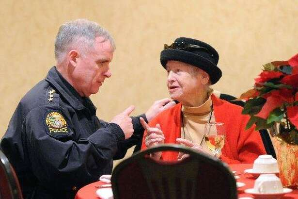 Anne Carson chats with Police Chief James Heavey at the Greenwich Knights of Columbus annual Christmas meal in 2013. Carson died last week.