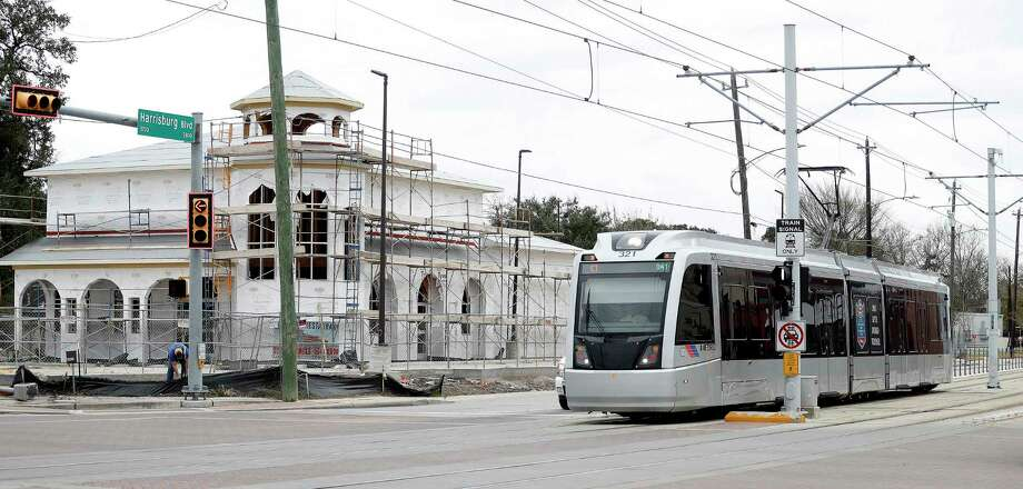 A Metro train makes it's way past new construction along Harrisburg on Jan. 9. Metro has plans for more light rail in Houston, but no current funding for projects. Photo: Karen Warren, Staff Photographer / 2016 Houston Chronicle