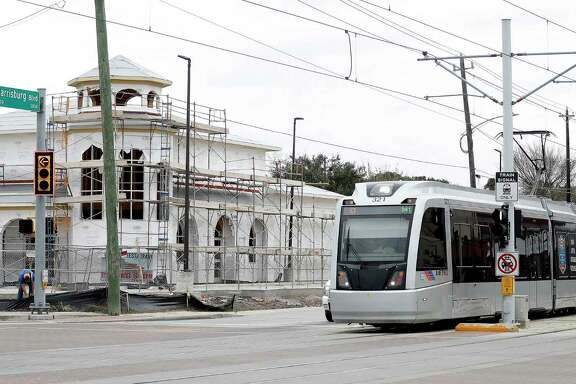 A Metro train makes it's way past new construction along Harrisburg on Jan. 9. Metro has plans for more light rail in Houston, but no current funding for projects.