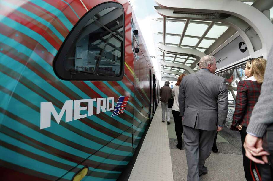 Passengers, including Metropolitan Transit Authority board members and senior staff, disembark after the inaugural Metro train took its first passengers across the recently-completed Harrisburg overpass on Jan. 9. Photo: Karen Warren, Staff Photographer / 2016 Houston Chronicle