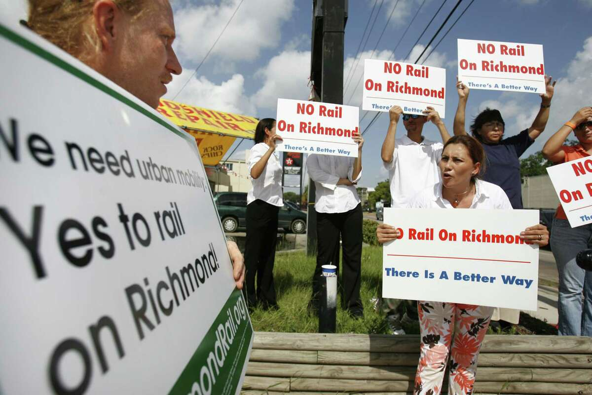 Metro opponent Monica Lopez Manteca, right, argues with Jeff Grant who is pro light rail during a gathering on Aug. 1, 2006 at the James Coney Island restaurant. Rail on Richmond remains the most divisive issue related to Metro rail expansion.