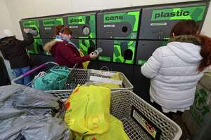 LInda Cerratio, center, and her daughter, Karissa, right, return bottles and cans to redeem the five-cent deposit at Stop and Shop on Connecticut Avenue Friday, February 17, 2017, in Norwalk, Conn. Connecticut Gov. Dannel P. Malloy has proposed doubling the five-cent deposit on beverages, provoking retailers and environmentalists alike. Environmentalists say the point of the 1980 recycling law was to reduce litter, not generate money from consumers who are too lazy to redeem their cans and bottles.