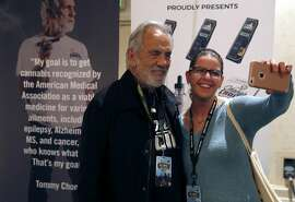 Carli Garcia snaps a selfie with Tommy Chong at the International Cannabis Business Conference in San Francisco, Calif. on Friday, Feb. 17, 2017.