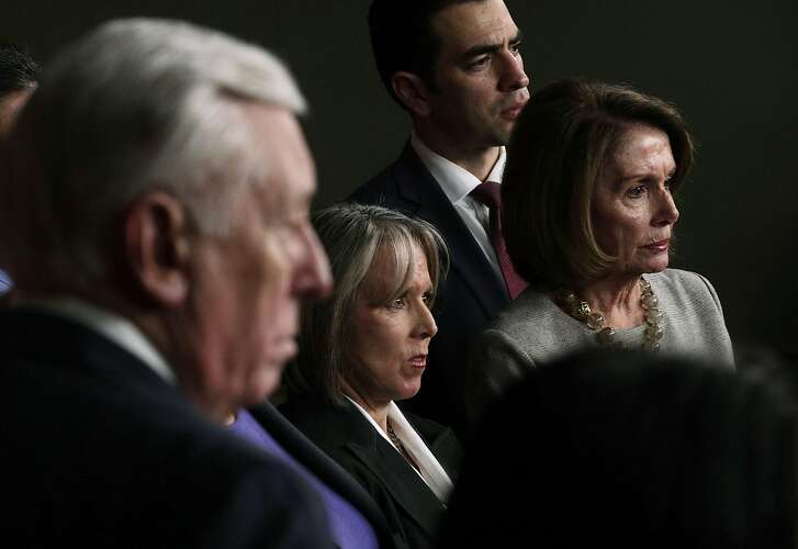 WASHINGTON, DC - FEBRUARY 16:  U.S. Rep. Michelle Lujan Grisham (D-NM) (2nd L), Chair of Congressional Hispanic Caucus, House Minority Leader Rep. Nancy Pelosi (D-CA) (R), House Minoriy Whip Rep. Steny Hoyer (D-MD) (L) and other House Democrats listen during a news conference February 16, 2017 on Capitol Hill in Washington, DC. House Democrats held a news conference to express their frustration after their meeting with ICE Acting Director Thomas Homan on the recent ICE raids.  (Photo by Alex Wong/Getty Images)