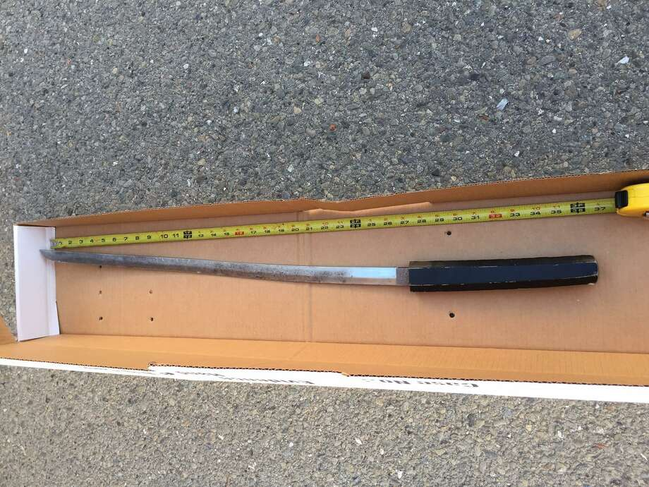 Manuel A. Ayala, 48, was arrested on suspicion of assault with a deadly weapon after striking a woman with the pictured sword, police said. Photo: Berkeley Police Department / / Berkeley Police Department