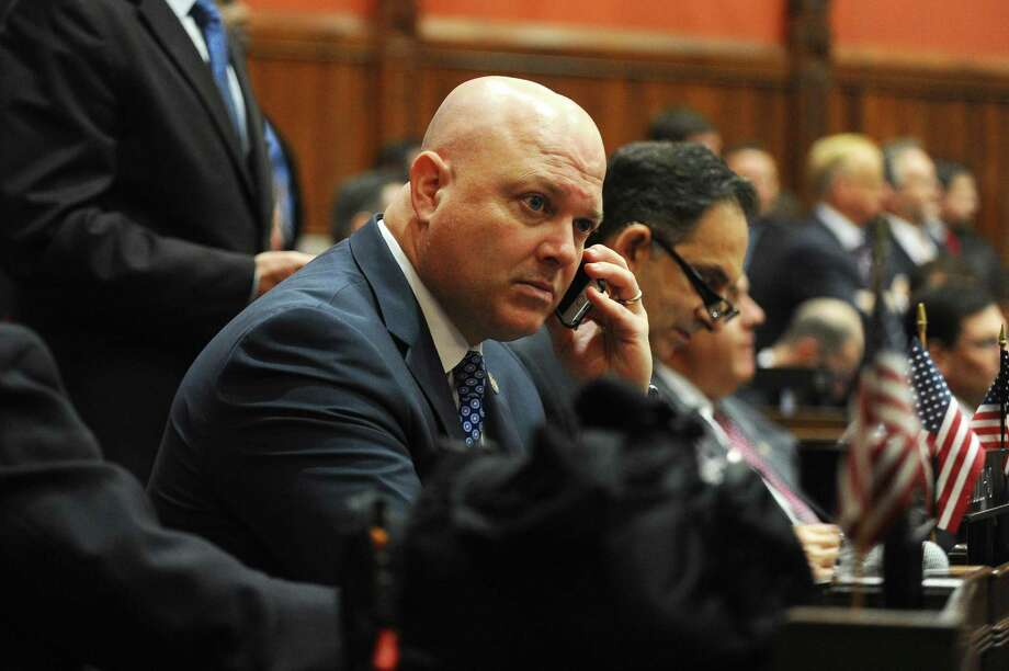Rep. Mike Bocchino, R-Greenwich, chats on the phone prior to Gov. Dannel Malloy's State of the State address inside the House Chambers of the Capitol in Hartford, Conn. on Wednesday, Feb. 3, 2016. Photo: Michael Cummo / Hearst Connecticut Media / Stamford Advocate