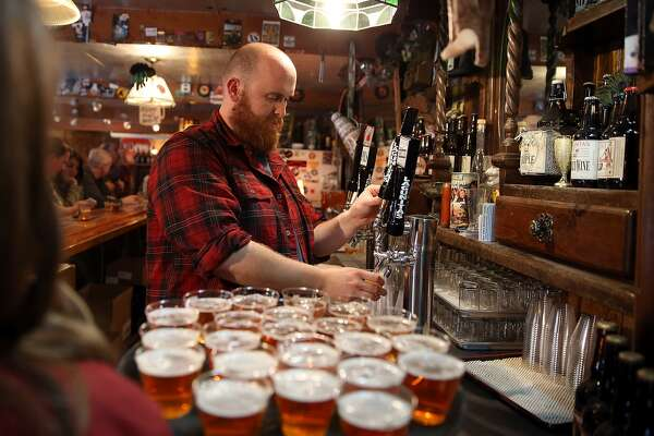 PETALUMA, CA - FEBRUARY 21: Tim Decker pours samples of Lagunitas Brewing Company beers during a brewery tour at Lagunitas Brewing Company on February 21, 2014 in Petaluma, California. Sonoma County breweries Lagunitas Brewing Company and Bear Republic rely on water from the Russian River and are worried that the extremely low water levels in the 110-mile waterway will force them to seek water from other sources, including well water, which could have an impact on the taste of their beers. (Photo by Justin Sullivan/Getty Images)