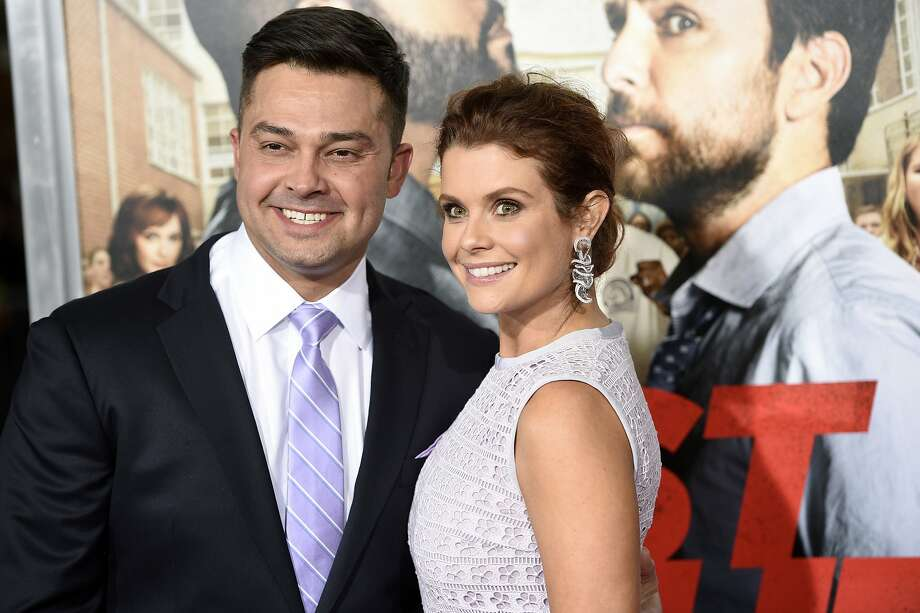 """JoAnna Garcia Swisher, right, a cast member in """"Fist Fight,"""" poses with her husband, professional baseball player Nick Swisher, at the premiere of the film on Monday, Feb. 13, 2017, in Los Angeles. (Photo by Chris Pizzello/Invision/AP) Photo: Chris Pizzello, Associated Press"""