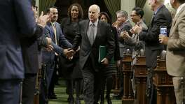 Calif., Gov. Jerry Brown is greeted by lawmakers as he enters the Assembly to deliver his annual State of the State address to a joint session of the state Legislature Tuesday, Jan. 24, 2017, in Sacramento, Calif. (AP Photo/Rich Pedroncelli)