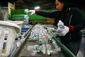 Employee Marianette Rodriguez works at seperating plastic bottles at MLI Redemption Services in Stratford, Conn., on Friday Feb. 17, 2017. Gov. Dannel P. Malloy has proposed doubling the five-cent deposit on beverages, provoking retailers and environmentalists alike. Environmentalists say the point of the 1980 recycling law was to reduce litter, not generate money from consumers who are too lazy to redeem their cans and bottles.