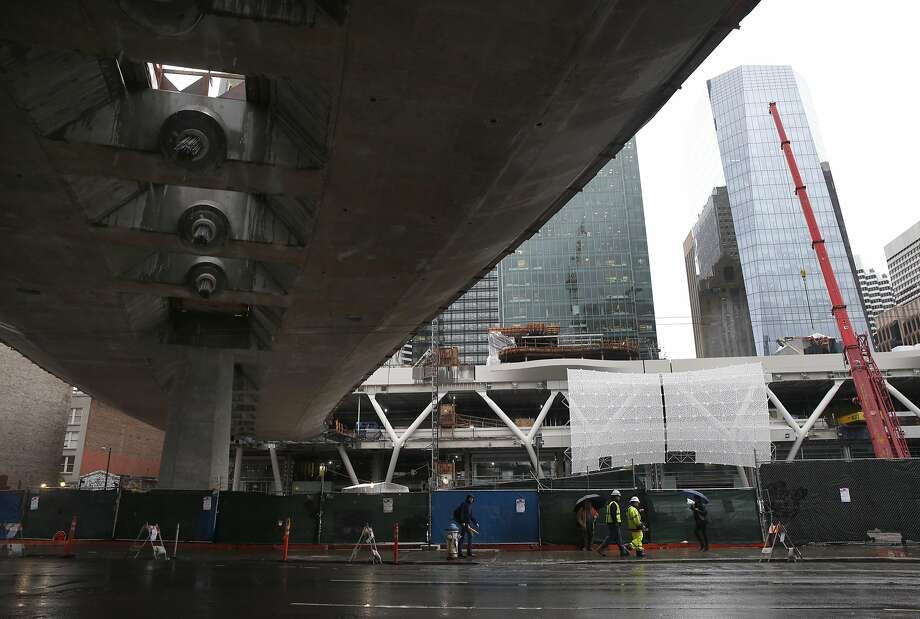 The Transbay Transit Center bridge, still under construction, extends above Howard Street. Photo: Paul Chinn, The Chronicle