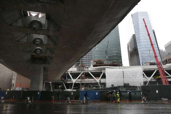 The Transbay Transit Center bridge, still under construction, extends above Howard Street between First and Second streets in San Francisco, Calif. on Friday, Feb. 17, 2017 where a number of large redevelopment projects are planned.