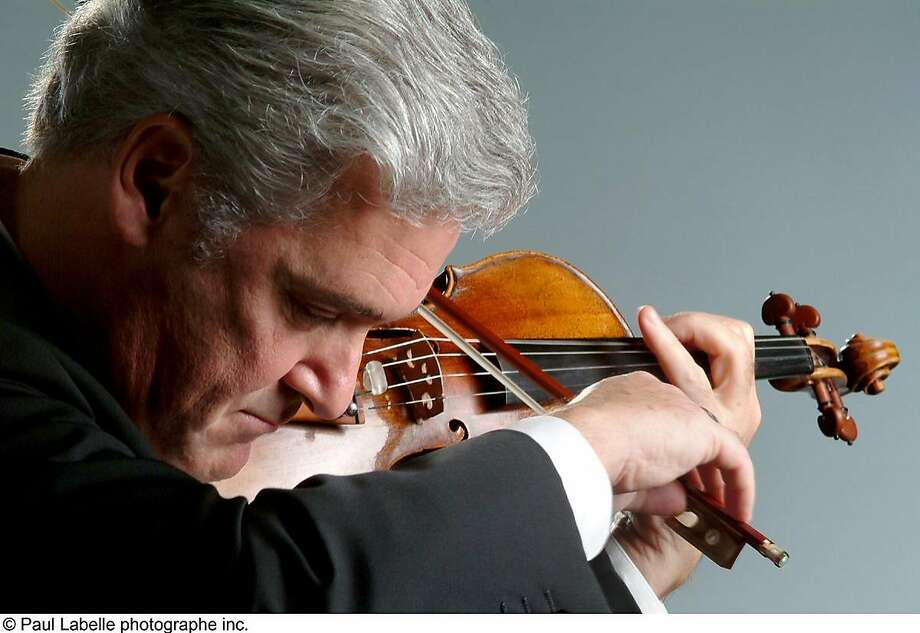 Violinist and conductor Pinchas Zukerman appears with the Royal Philharmonic Orchestra Sunday and Monday Photo: Paul Labelle