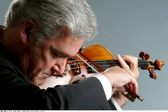 Violinist and conductor Pinchas Zukerman appears with the Royal Philharmonic Orchestra Sunday and Monday
