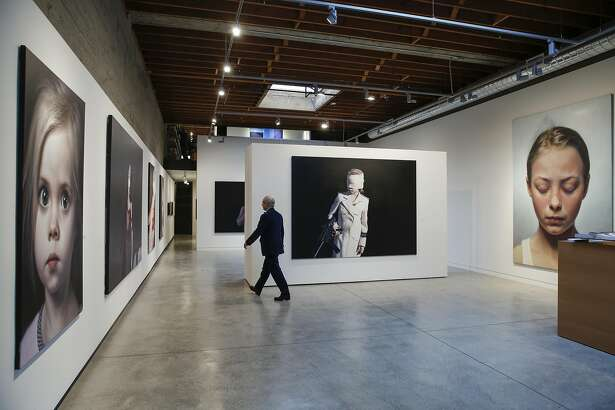 Modernism Inc. owner Martin Muller walks through his gallery with works by Gottfried Helnwein on exhibition on Friday, Feb. 17, 2017 in San Francisco, Calif.