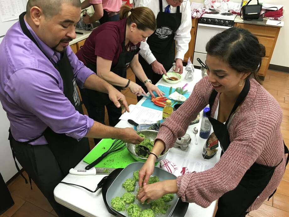 Amy Ressler, center left, leads employees for the City of Willis in a Workplace Wellness program. She brought the Texas A&M AgriLife Extension Service's Mobile Cooking School to the group.