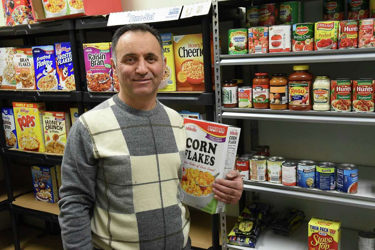 Ayman Akari stands in front of the newly established food pantry at the Muslim Community Center on Thursday, Feb. 16, 2017 in Colonie, N.Y. The pantry will be open to serve needy members on the second Saturday of every month.(Lori Van Buren / Times Union)