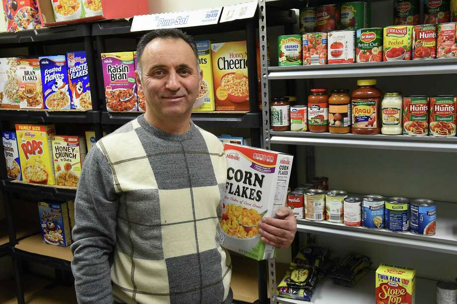 Ayman Akari stands in front of the newly established food pantry at the Muslim Community Center on Thursday, Feb. 16, 2017 in Colonie, N.Y. The pantry will be open to serve needy members on the second Saturday of every month.(Lori Van Buren / Times Union) Photo: Lori Van Buren / 20039671A