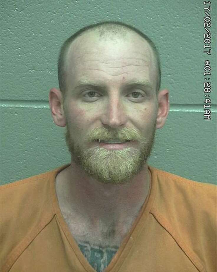 Dominic Todd Renfroe, 30, was arrested Wednesday after he allegedly confronted a man with two weapons, according to court documents. Photo: Midland County Sheriff's Office
