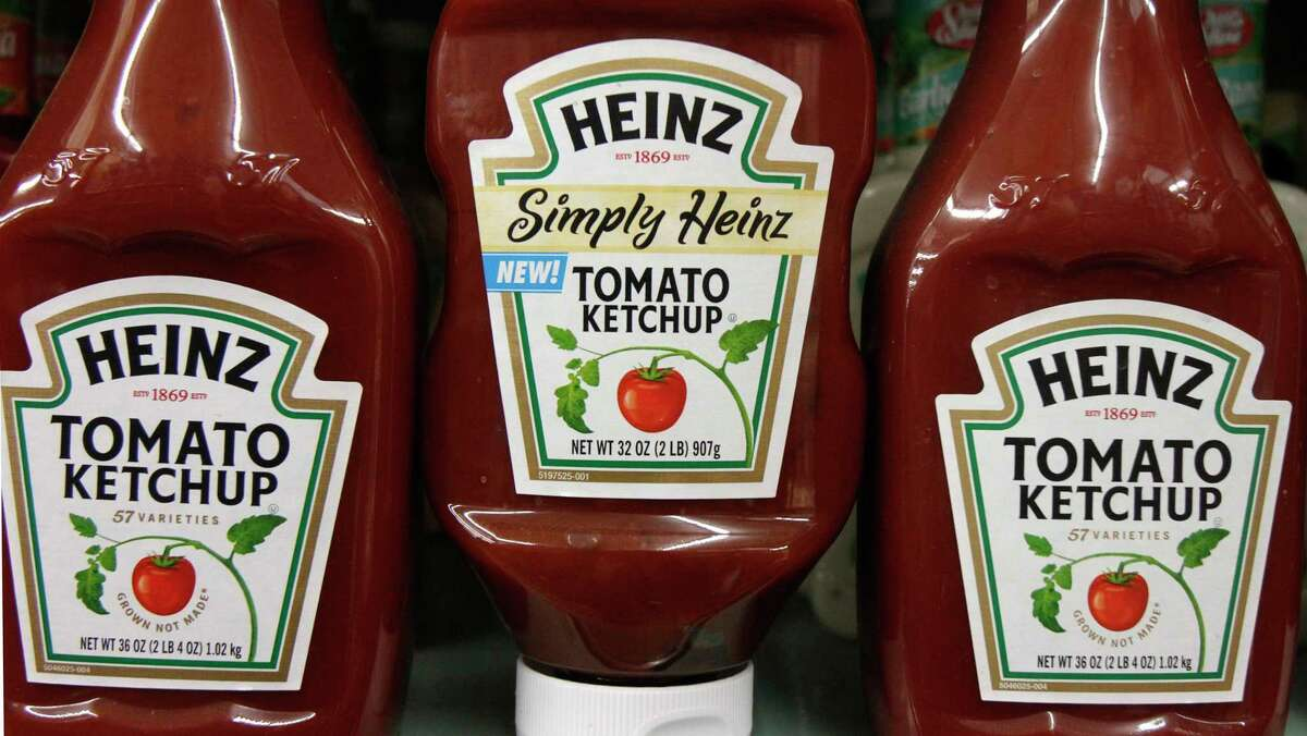 FILE- In this March 2, 2011, file photo, Heinz ketchup bottles are displayed on the shelf of a market on in Barre, Vt. U.S. food giant Kraft Heinz Co. says its offer to buy Europe?'s Unilever was rejected, but that it is still pursuing the deal. The maker of Oscar Mayer meats, Jell-O pudding and Velveeta cheese said there?'s no certainty that it will make another offer for Unilever, which owns brands including Hellmann?'s, Lipton and Knorr. (AP Photo/Toby Talbot, File) ORG XMIT: NY158