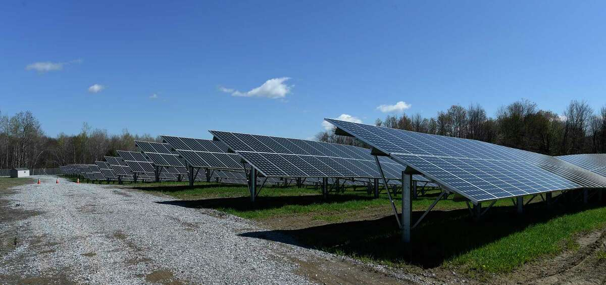 Private solar panels adjacent to the location of the first shared renewables solar project in the State are already in service Wednesday April 27, 2016 in Halfmoon, N.Y. (Skip Dickstein/Times Union)