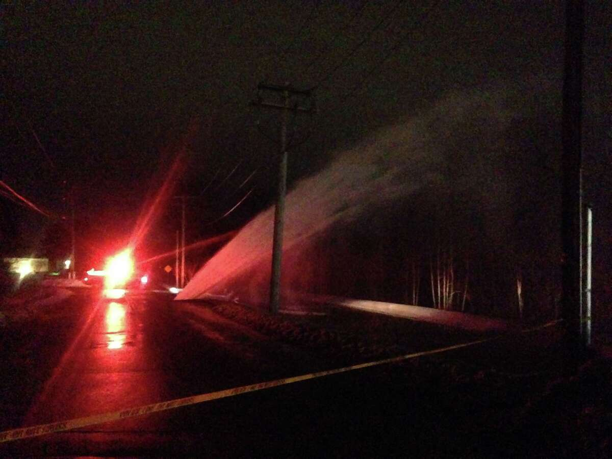 A water-main break Friday evening led to a geyser of water just off Route 4 in North Greenbush. (Steve Barnes/Times Union.)