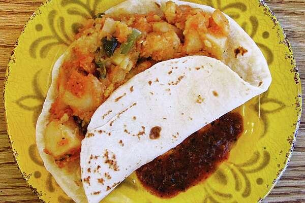 Papas rancheras taco on a handmade flour tortilla from Mi Celayence Mexican Restaurant on Fredericksburg Road.