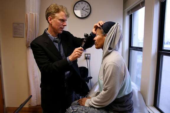 From right: Sonia Hernandez gets her eyes checked by doctor Andrew Desruisseau at the Tenderloin Health Services on Friday, Feb. 17, 2017, in San Francisco, Calif. Hernandez is a Hepatitis C patient.