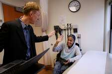 From left: Doctor Andrew Desruisseau high-fives Sonia Hernandez during her appointment at the Tenderloin Health Services on Friday, Feb. 17, 2017, in San Francisco, Calif. Hernandez is a Hepatitis C patient.