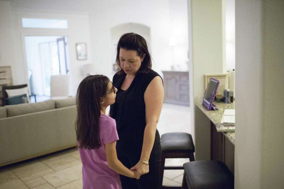Heather Beliveaux of Pearland holds her daughter Sophia Salehi as they talk about a children's book in December. Salehi, who is legally blind, was a student at a private school after she was denied special education several times by the Houston Independent School District. Photo: Marie D. De Jesus /Houston Chronicle / © 2016 Houston Chronicle