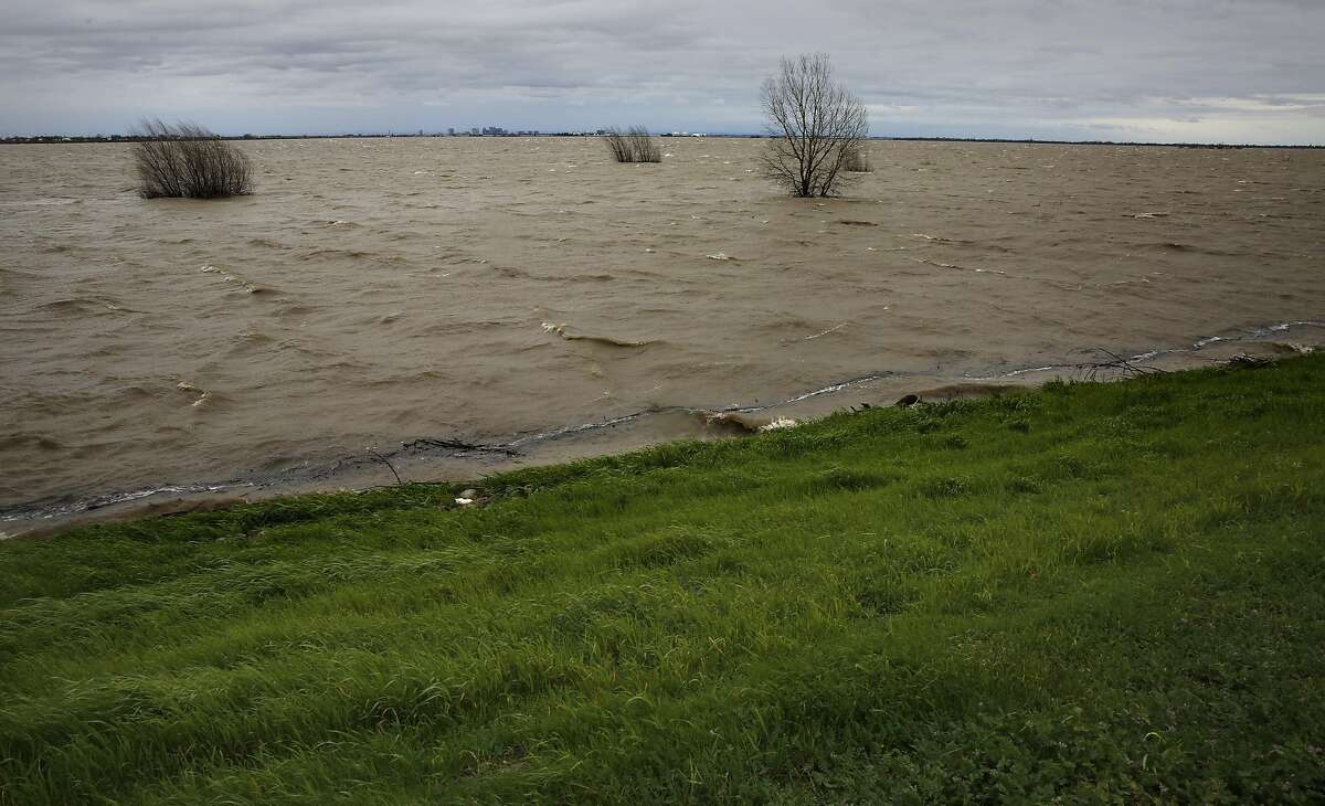 The Yolo Bypass filled with water from the Sacramento River after the Sacramento weir was opened for the first time since 2006, as seen on Friday Feb. 17, 2017, in Sacramento, Ca.