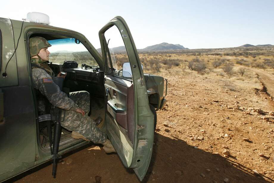 A National Guard unit patrols at the Arizona-Mexico border in Sasabe, Ariz. in 2007. Photo: Ross D. Franklin / AP File Photo / AP