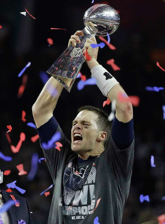 New England Patriots quarterback Tom Brady hoists the Lombardi Trophy  for the fifth time, the most for a quarterback in Super Bowl history.  (AP Photo/Elise Amendola) Photo: Elise Amendola, STF / Copyright 2017 The Associated Press. All rights reserved.