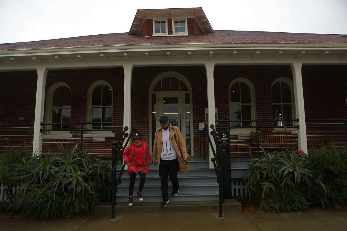 Mikayil Tokdemir leaves the Presidio Visitors Center after his first visit with his daughter, Aleyna, inside the Presidio Visitors Center on Friday, Feb. 17, 2017, in San Francisco, Calif.
