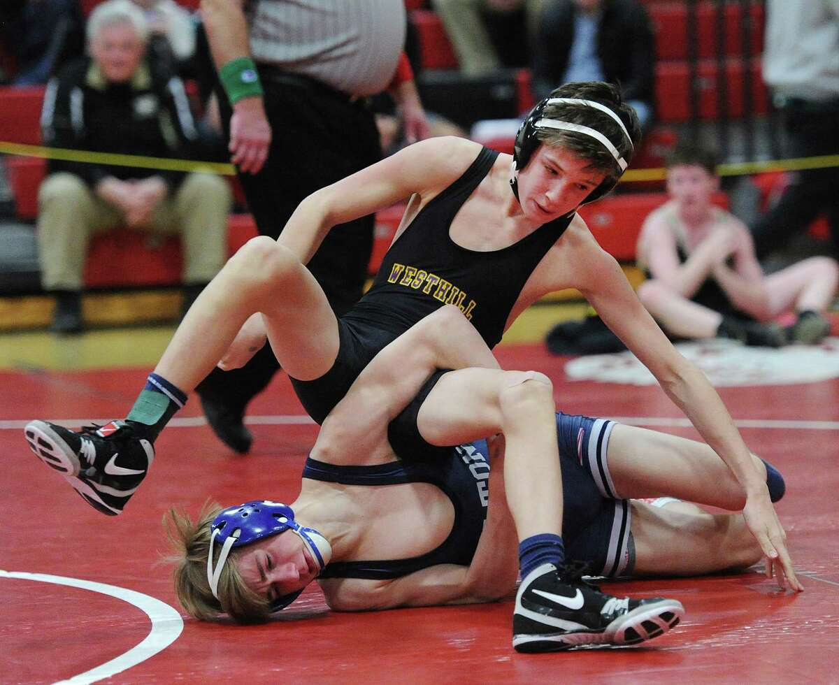 Westhill's Chase Parrott, top, is seen in the 106 pound consolation match he lost to Travis Longo of Wilton, bottom, in the FCIAC Wrestling Championships at New Canaan High School on February 11.