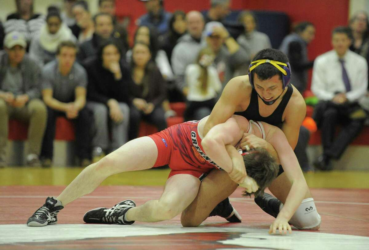 Westhill's Brandon Chejin controls Greenwich's Kevin Jewell in the 132 pound bout during a wrestling match at Greenwich High School on February 1.