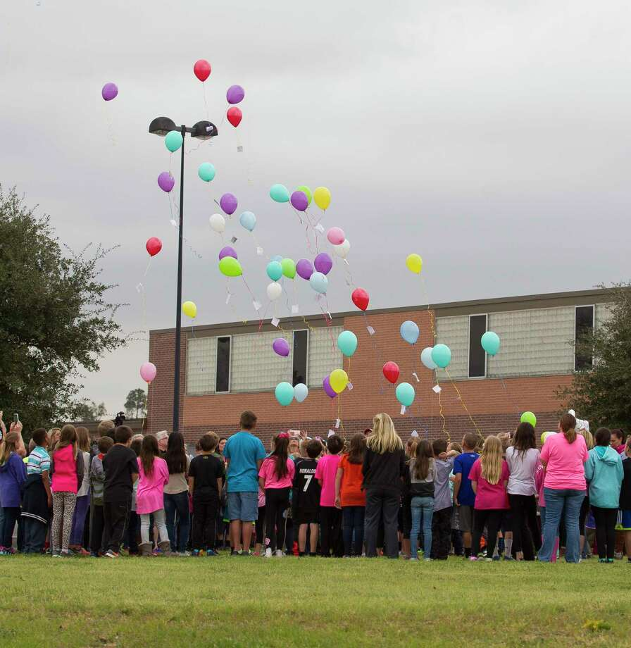 Students, teachers and visitors take part in a balloon release in honor of fourth-grade teacher Jenny Runnels at Lone Star Elementary Friday, Feb. 17, 2017, in Montgomery. Runnels died after being hospitalized from a head-on collision at FM 2854 near Honea Egypt Road Wednesday afternoon that left her and the other driver Floyd Nelms, Jr., 31, dead. Runnels' 10-year-old daughter is in stable condition at Texas Children's Hospital in Houston, according to school officials. Photo: Jason Fochtman, Staff Photographer / © 2017 Houston Chronicle