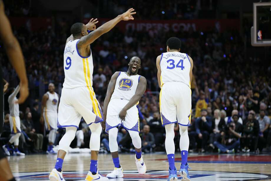 Golden State Warriors' Draymond Green, center, Andre Iguodala, left, and Shaun Livingston, right, celebrate a three pointer by teammate Harrison Barnes, not pictured, during the second half of an NBA basketball game, Saturday, Feb. 20, 2016, in Los Angeles. The Warriors won 115-112. (AP Photo/Danny Moloshok) Photo: Danny Moloshok, Associated Press