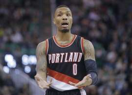 Portland Trail Blazers guard Damian Lillard (0) reacts to a no call during the first half of an NBA basketball game against the Utah Jazz Wednesday, Feb. 15, 2017, in Salt Lake City. (AP Photo/Rick Bowmer)