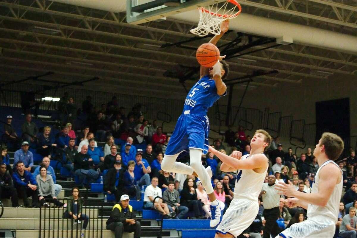 Clear Springs' Tylan Jackson (5) slams home a dunk against Friendswood Friday, Feb. 17 at Dickinson high School.