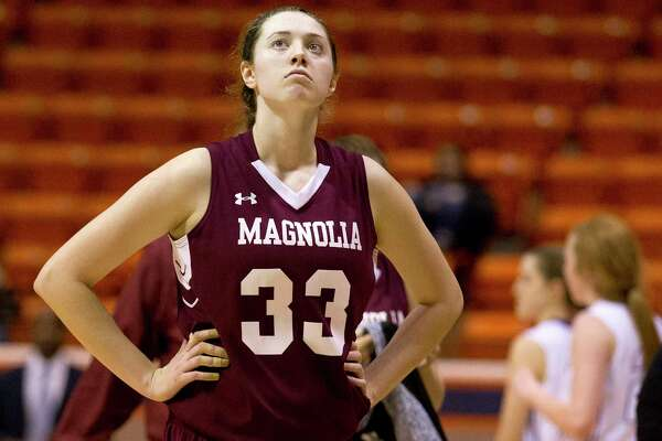 Magnolia forward Katie Dalton (33) looks up at the scoreboard as she walks off the court following a 53-48 loss to College Station in a Region III-5A area girls basketball playoff game at Bernard G. Johnson Coliseum Friday, Feb. 17, 2017, in Huntsville.