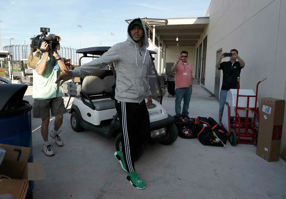 Astros shortstop Carlos Correa has a good reason for arriving fashionably late to training camp Friday afternoon. He had four wisdom teeth taken out Thursday. Photo: Karen Warren, Staff Photographer / 2017 Houston Chronicle