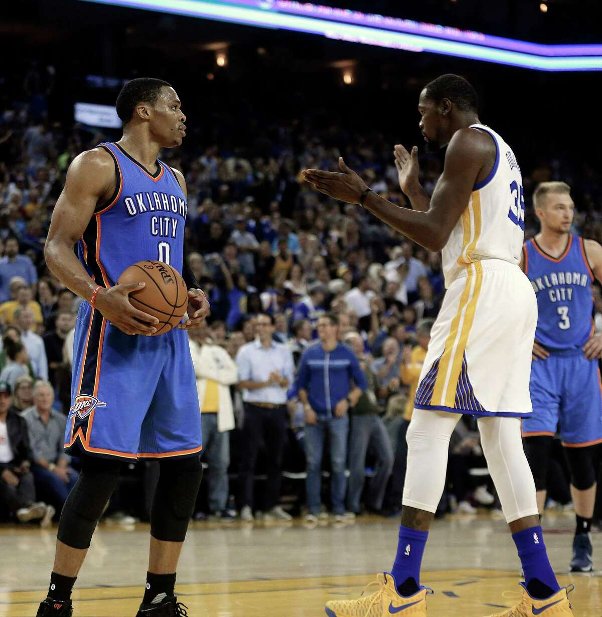 FILE - In this Nov. 3, 2016, file photo, Golden State Warriors' Kevin Durant, right, celebrates in front of Oklahoma City Thunder guard Russell Westbrook (0) during the first half of an NBA basketball game, in Oakland, Calif. The next time Russell Westbrook walks into a locker room for a game, Kevin Durant will be there. Get ready for the perhaps the best subplot of All-Star Weekend. The former Oklahoma City teammates and now rivals play as Western Conference teammates Sunday night, Feb. 19, 2017.(AP Photo/Ben Margot, File) ORG XMIT: NY172