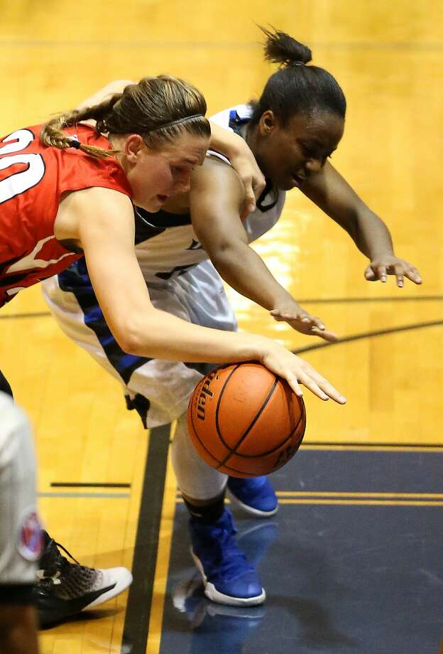 Katy's Laura Rowe (left) attempts a steal on Westside's Stephanie Gregory during a high school basketball game on Friday, Feb. 17, 2017, in Houston. ( J. Patric Schneider / For the Chronicle ) Photo: J. Patric Schneider/For The Chronicle