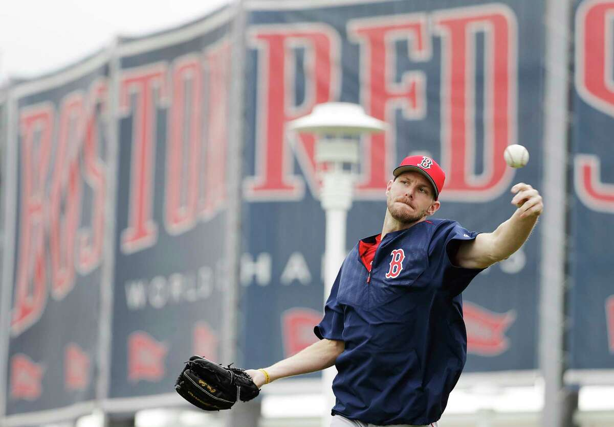 Boston Red Sox pitcher Chris Sale throws the ball during baseball spring training in Fort Myers, Fla., Monday, Feb. 13, 2017. (AP Photo/David Goldman) ORG XMIT: FLDG112